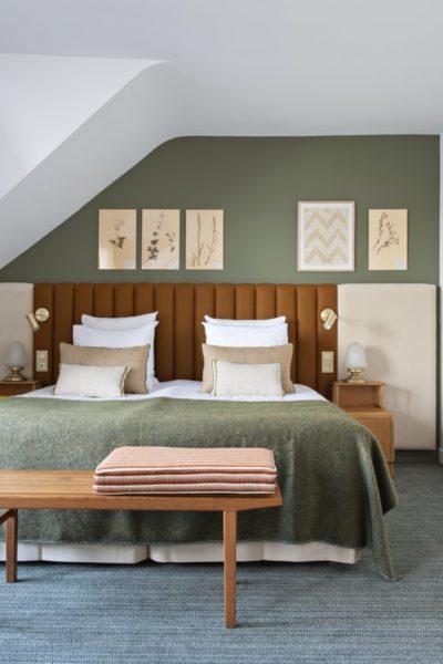 Suite Junior avec grand lit et belle décoration